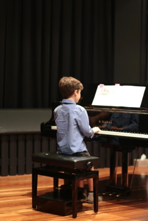 Asher performing at the End of Year Concert